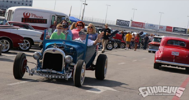 Family of five Riding in Blue Ford Hot Rod