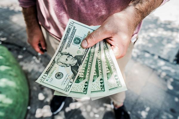 man holding extra cash