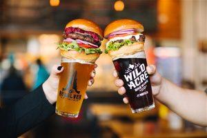 2 burgers atop 2 beers